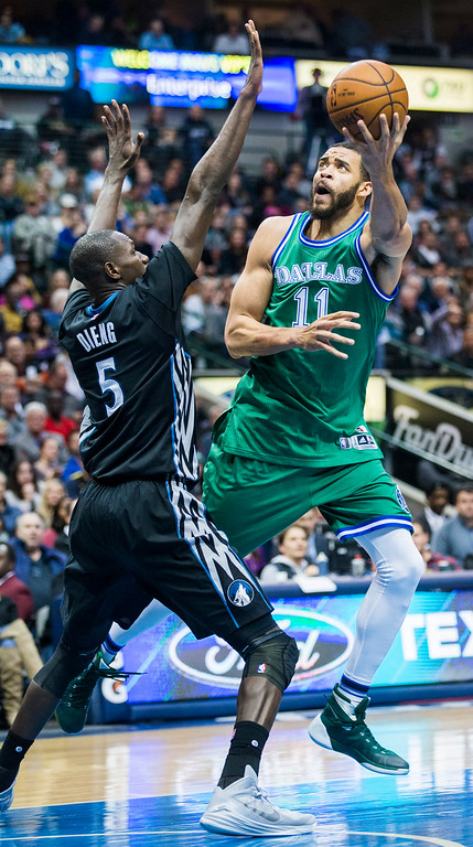 . The Dallas Mavericks\' JaVale McGee (11) takes a shot around the Minnesota Timberwolves\' Gorgui Dieng (5) during the second quarter on Wednesday, Jan. 20, 2016, at the American Airlines Center in Dallas. (Ashley Landis/Dallas Morning News/TNS)