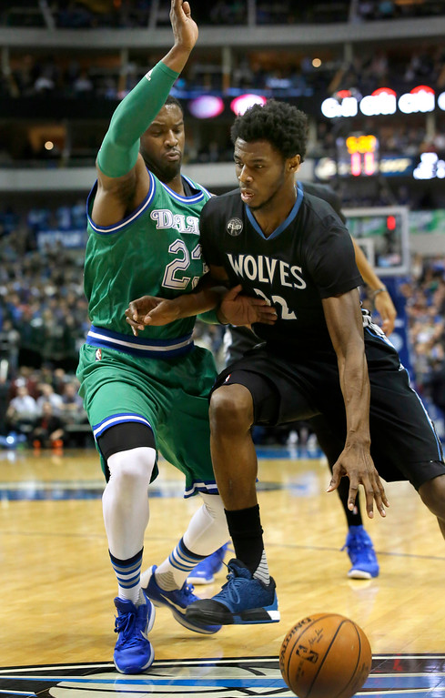. Minnesota Timberwolves guard Andrew Wiggins (22) drives against Dallas Mavericks guard Wesley Matthews (23) during the first half of an NBA basketball game Wednesday, Jan. 20, 2016, in Dallas. (AP Photo/LM Otero)