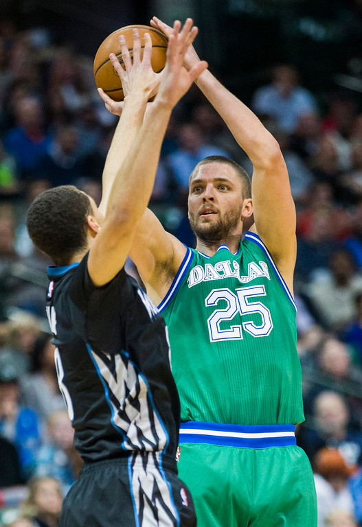 . The Dallas Mavericks\' Chandler Parsons (25) takes a shot over the Minnesota Timberwolves\' Zach LaVine during the second quarter on Wednesday, Jan. 20, 2016, at the American Airlines Center in Dallas. (Ashley Landis/Dallas Morning News/TNS)