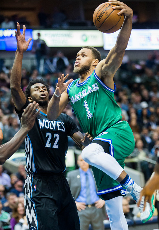 . The Dallas Mavericks\' Justin Anderson (1) takes a shot over the Minnesota Timberwolves\' Andrew Wiggins (22) during the first quarter on Wednesday, Jan. 20, 2016, at the American Airlines Center in Dallas. (Ashley Landis/Dallas Morning News/TNS)