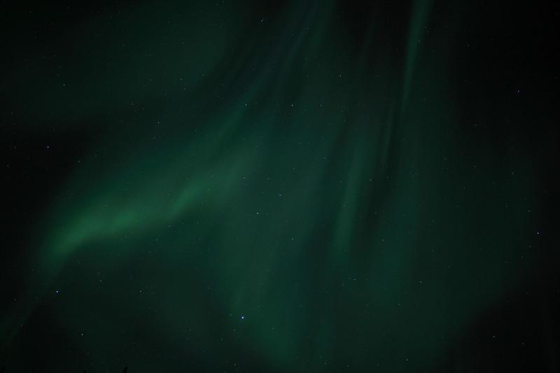 Aurora swirling overhead<br><br>Canon EOS 5D Mark II, Zeiss Distagon 25mm f/2.0 ZE lens