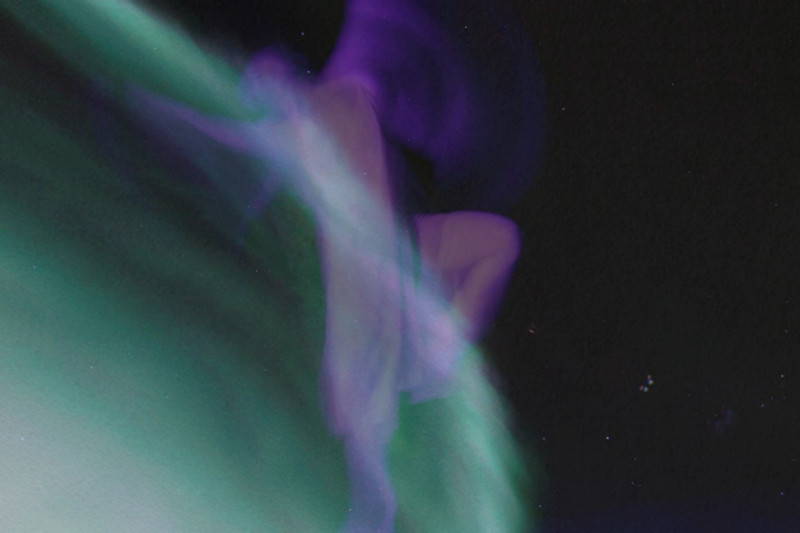 """Scene out of """"The Divine Feminine"""" - Image 5  of an auroral display in Alaska merging with aurora-inspired paintings by Linda DeHart, create an ethereal Divine Feminine enfolding the archetypal gestures of dancer Meg Brooker.  Aurora photography and audio composition/production by Dirk Obudzinski Dance photography and visual compositing by Christopher Graefe <a href=""""http://colorsinmotion.com/"""">Colors in Motion</a>"""