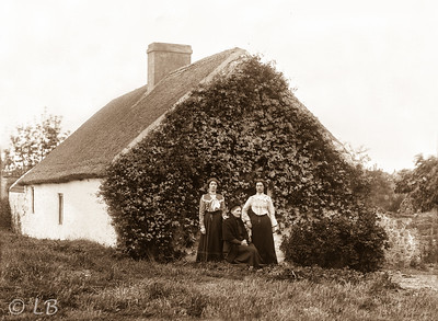 3 Women at gable of house