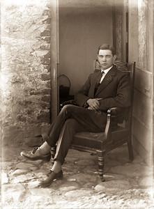 Man seated at Half Door 1
