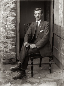 Man seated at half door 2