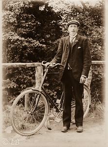 Man & Bicycle on Bridge