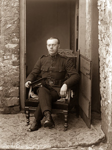 Policeman in Armchair