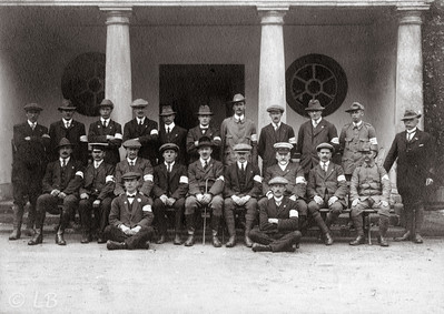 Group of men with armbands