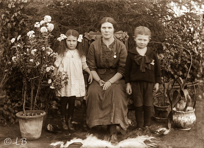 Mother and 2 children in a garden