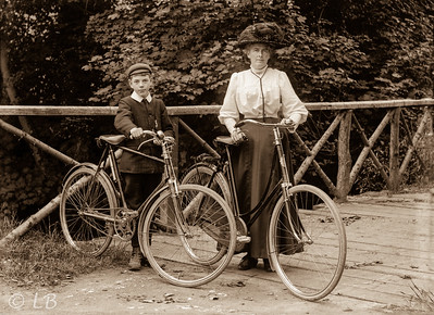 Woman & boy with bicycles