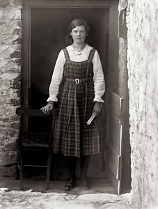 Girl in a tartan pinafore