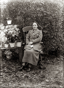Woman in chair in garden