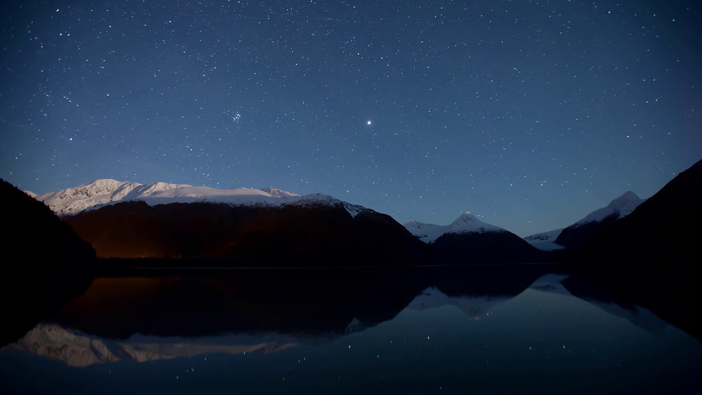 1 hour time lapse of the night sky over Portage Lake in Southcentral Alaska between 11:00 pm and 12:00 am<br /> <br /> October 04, 2011<br /> <br /> Best viewed in Hi-Def