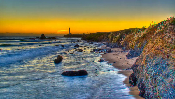 One of my first day light time-lapse photographs. It was a bit windy, so there is some shake. Pigeon Point Lighthouse Sunset.