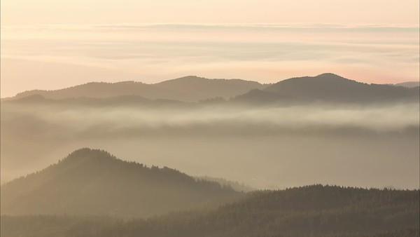 Smoke Through The Valley At Sunset