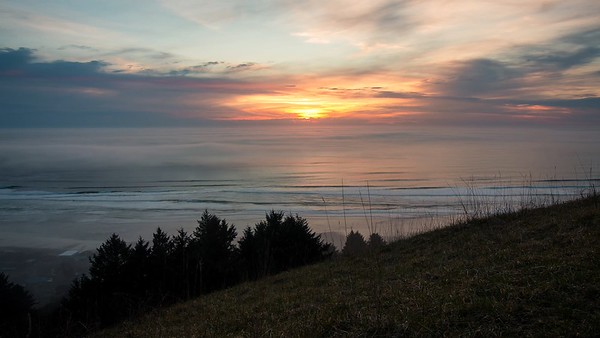 Foggy Sunset Over Oregon Coast