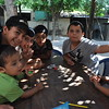 """""""After explaining the rules of the Dreidel game, the kids and teens of the community were excited to get started! We played with stickers for gelt."""" Photo by Kimberly Duenas, December 2012."""