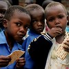 Students tasting Passover matzah at Hadassah Infant School, Budi Zone near Mbale, Uganda, 2003.