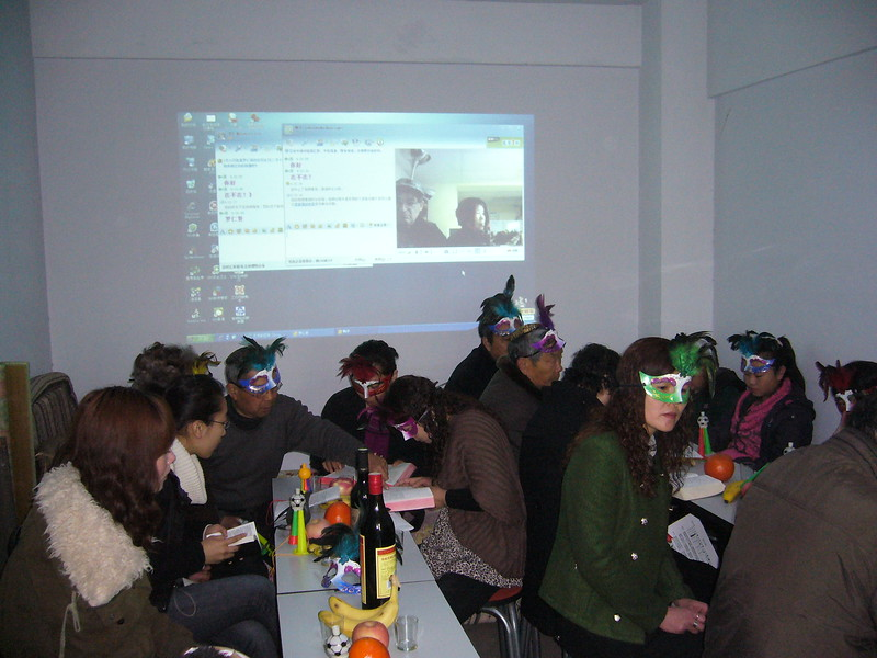 Kulanu volunteers Rabbi Jack Bresler and Denise Yeh Bresler from Potomac, MD, USA celebrate Purim over online connection with Jewish community in Kaifeng, China.