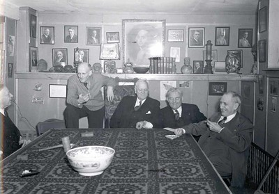 Harry Ruggles, Paul Harris, Silvester Schiele, Barney Arntzen, and Rufus Chapin at a reunion of the earliest members of the Rotary Club of Chicago at Comely Bank. December 1942.