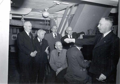 "Montague ""Monty"" Bear, Barney Arntzen, Rufus Chapin, Robert Fletcher, Harry Ruggles, Paul Harris, and Silvester Schiele sing at a reunion of the earliest members of the Rotary Club of Chicago at Comely Bank. December 1942."
