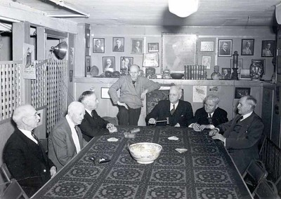 "Montague ""Monty"" Bear, Harry Ruggles, Paul Harris, Silvester Schiele, Barney Arntzen, Rufus Chapin, and Robert Fletcher at a reunion of the earliest members of theRotary Club of Chicago at Comely Bank. December 1942."