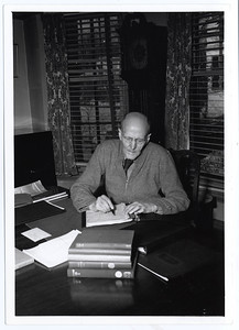 Paul Harris writing in a notebook at his desk, probably at Comely Bank in Chicago, Illiinois, USA.