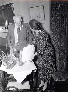 "Jean Harris prepares tea as Montague ""Monty"" Bear looks on at a reunion of the earliest members of the Rotary Club of Chicago at Comely Bank. December 1942."