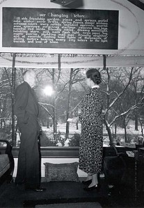 Paul and Jean Harris in front of the picture window at their Chicago home, Comely Bank. December 1942.