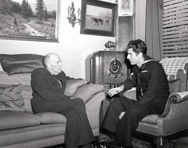 Paul Harris talks with an unidentified sailor at Comely Bank. December 1942.