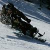 Man in Mono-Ski skiing fast