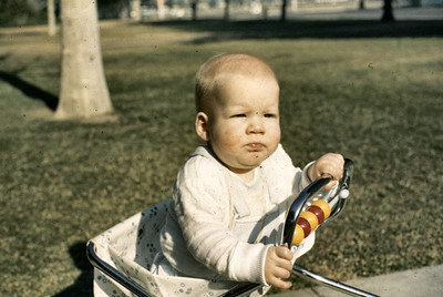 Another picture of John in his walker when he was about five or six months old.