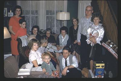 Christmas Eve in Jamestown at the Duanes. Left to right: Shirley, Craig, Great Grandma Duane?, Catherine, Kathy, Gary, Grandma Potwin, John, Pat, Harry, Aunt ??, Francis, Linda.