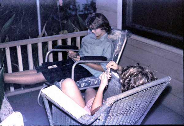 Linda and Kathy playing cards on our front porch.