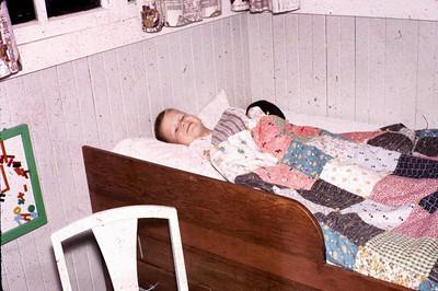 John in bed