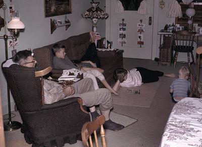 Evald (grandpa), Gary, Linda, Kathy and John in the living room watching TV