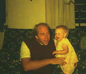 KIM WAS A VERY HAPPY BABY AND SHE LOVED HER DADDY.