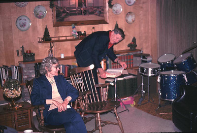 This is Ethel Newman and Bob Cossentine in our family room with Johns drum set.