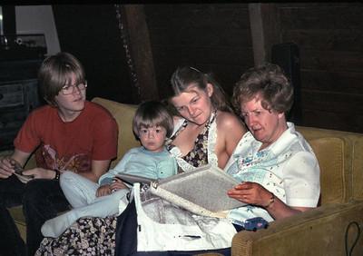 John, Joe, Linda and pat looking at wedding pictures.