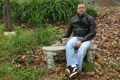 Joe sites on bench at memorial gardens - Asheville, North Carolina
