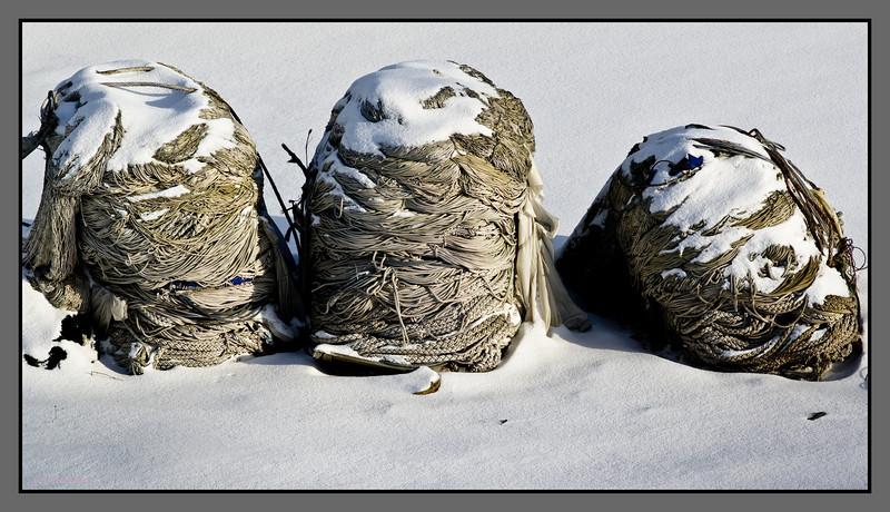 Three<br /> Fishing nets awaiting spring at Burøya, Bodø