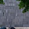 Stone wall and umbrellas<br /> Museum of Modern Art