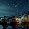Star trails over the moonlit harbour<br /> Nyksund