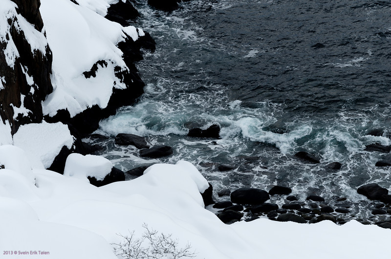 Snow, cliffs and the ocean I<br /> Shoreline by Nyksund