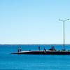 Shimmering, bright<br /> Fishing on the ferry quay, Paleochora