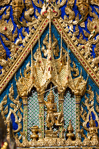 A Deity with Sword in the Five-Pinnacle Castle on the Pediment of Phra Ubosot, Wat Arun Ratchawararam
