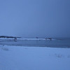 BLUE I<br /> February and gusts of snow – something about this feels known and beloved. Along the Sortland sound the boat houses become small signs in the grand blueness.<br /> <br /> BLÅTT I<br /> Februar og snøbyger – det er noe kjent og kjært ved dette. Langs Sortlandssundet blir naustene små tegn i det store blå landskapet.