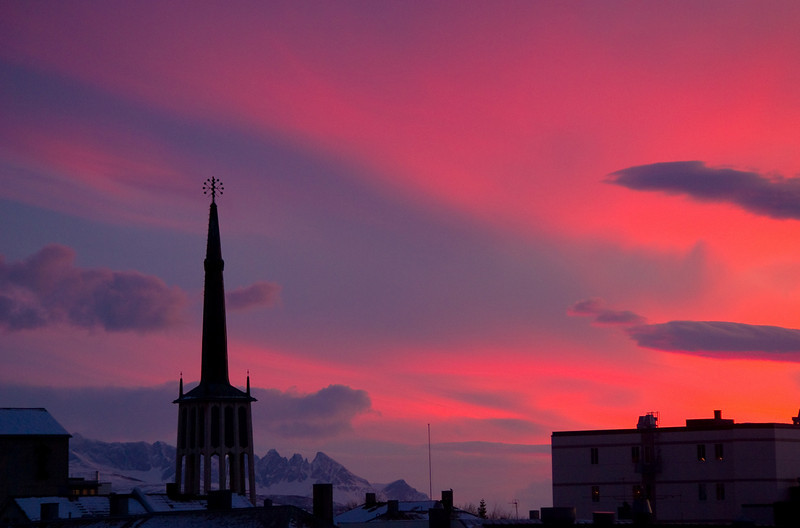 Cathedral spire and burning sky