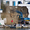 "The ferry Daskalogiannis brought heavy machinery the other day. I askes one of the restaurant keepers what was going on, and he replied: ""Oh, mr. NN is going to fix up his house a little bit"": The next morning this scene occured - mr NN was clearly going to do a major makover on his house..."