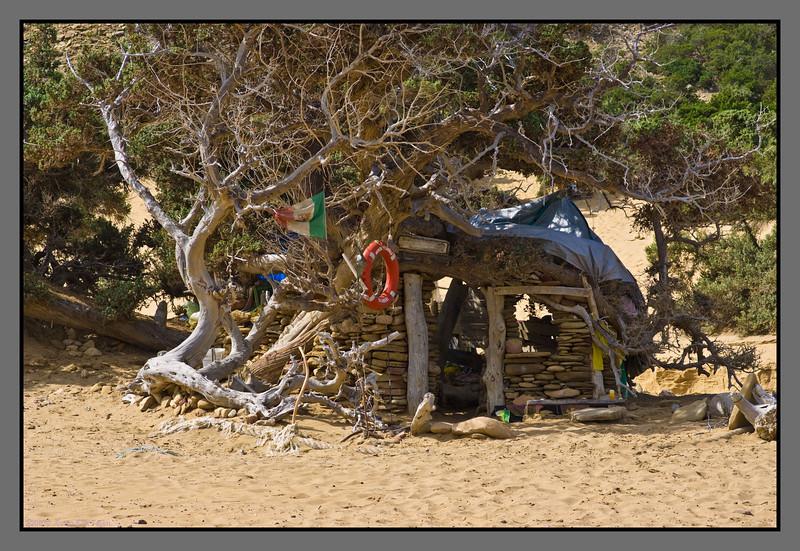 Living among the old cedar trees<br /> Camp site/hut, Agios Ioannis beach